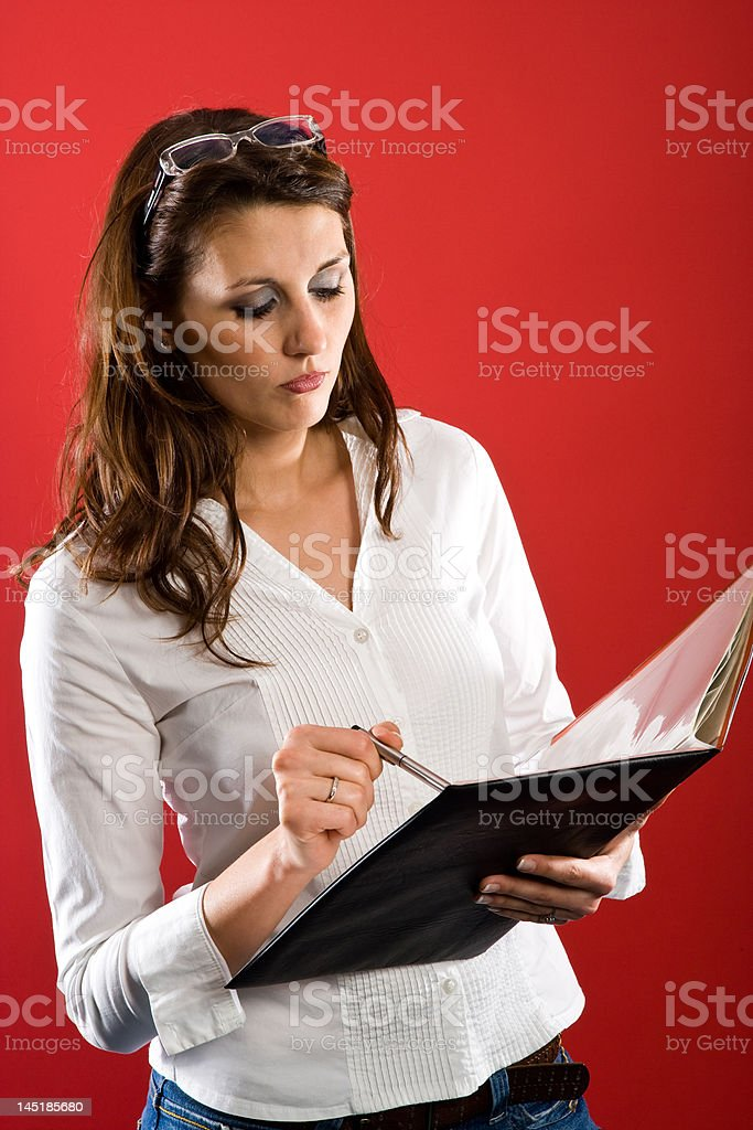 Reading financial statements royalty-free stock photo