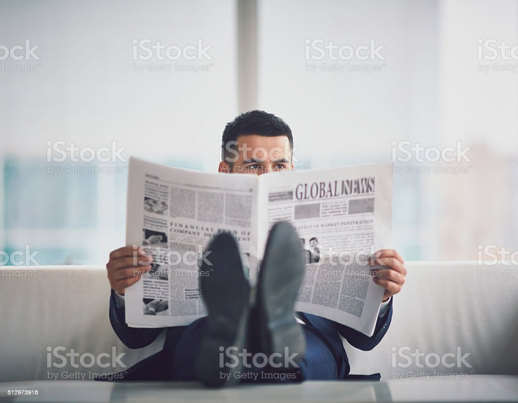 Reading fresh news stock photo