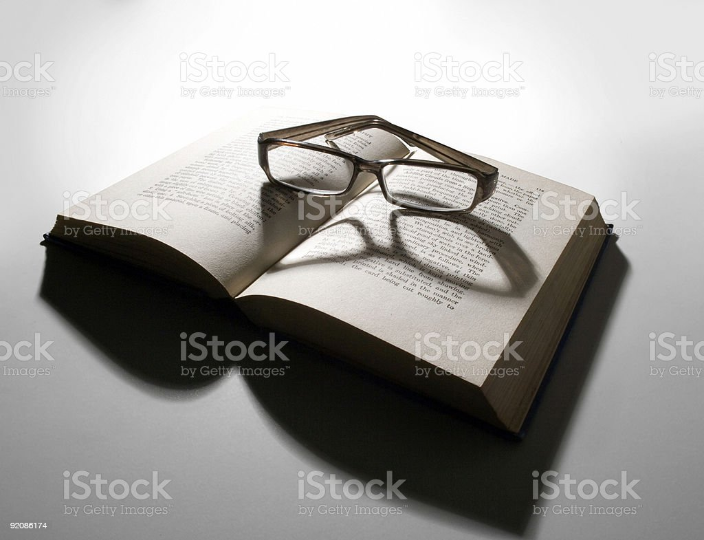 Reading glasses and open book royalty-free stock photo