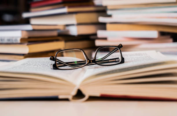 Reading glasses on a book. stock photo