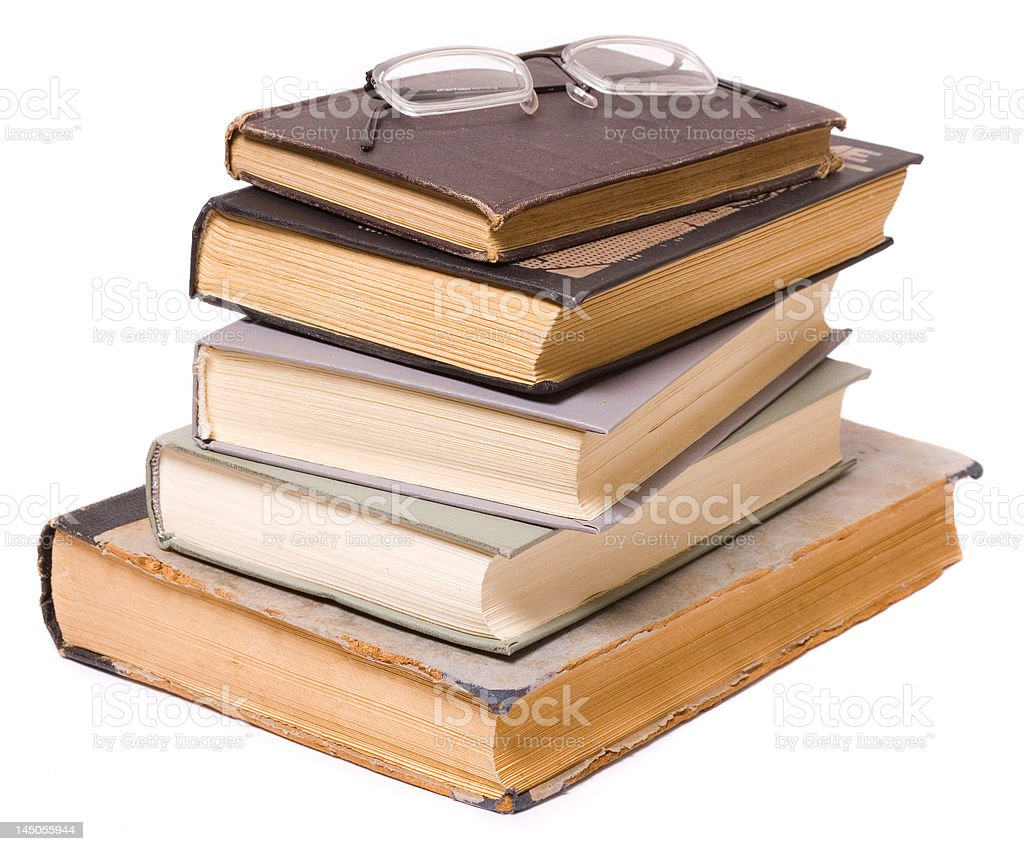 Reading - glasses on a pile of books royalty-free stock photo