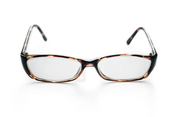 reading glasses on a white background stock photo