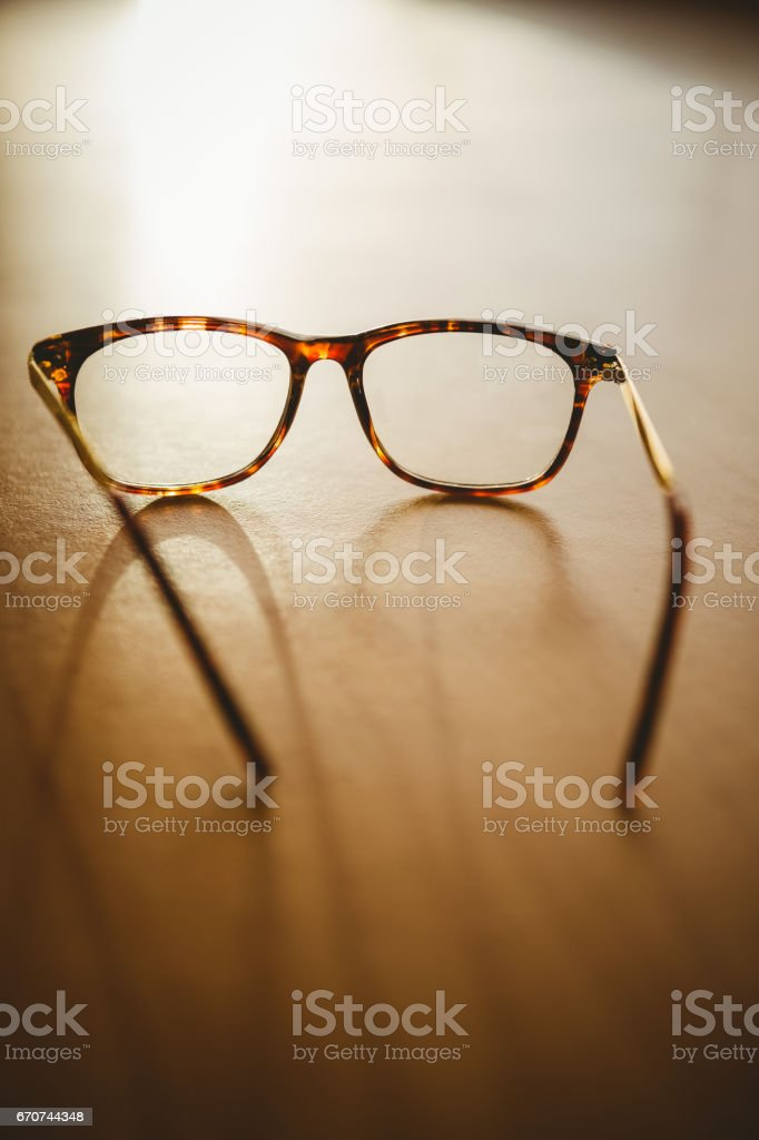 Reading glasses on table stock photo