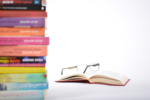 istock Reading glasses on top of a open book. 862693916