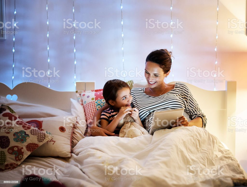 Reading her a bedtime story stock photo