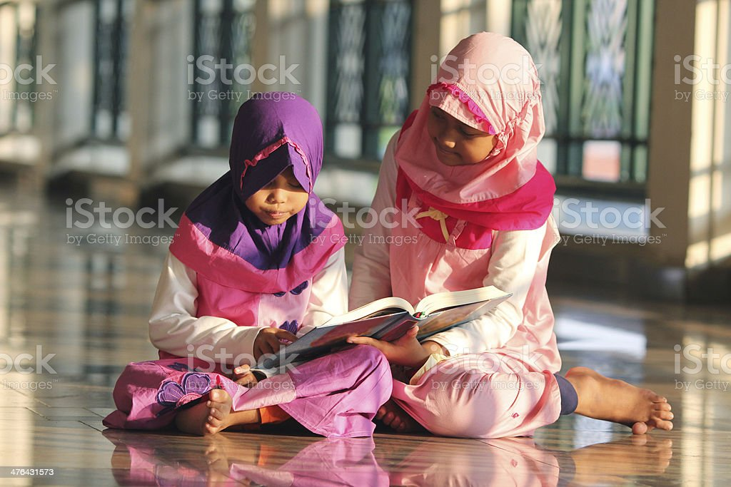 Reading Holy Quran stock photo