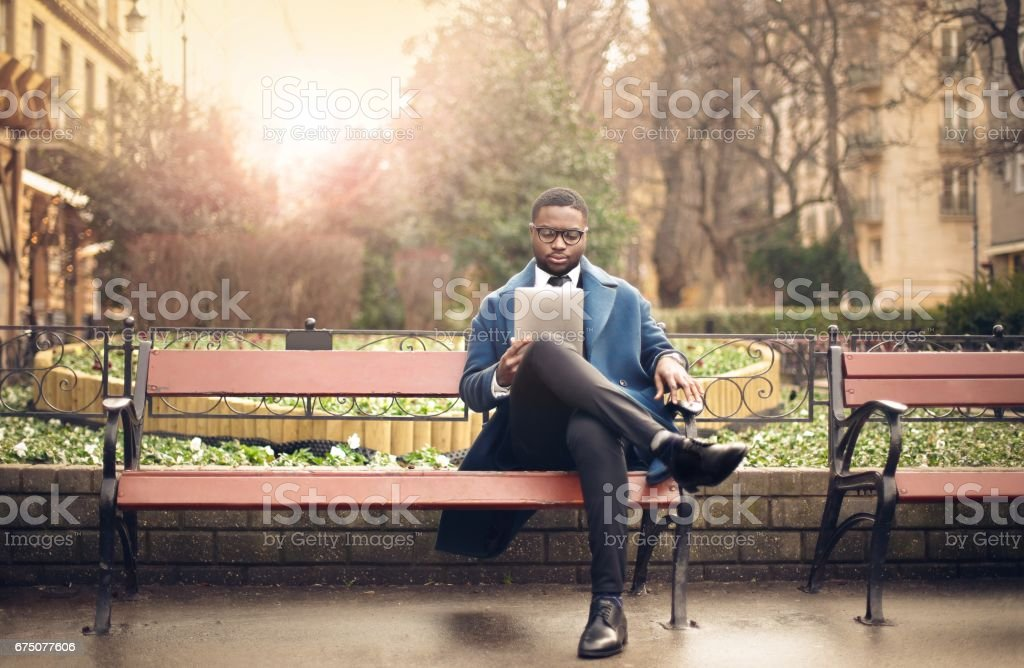 Reading in a park stock photo