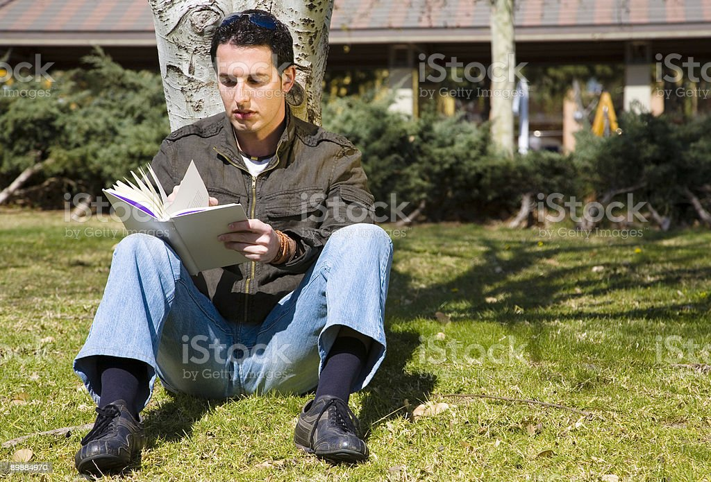 Reading in a park royalty-free stock photo