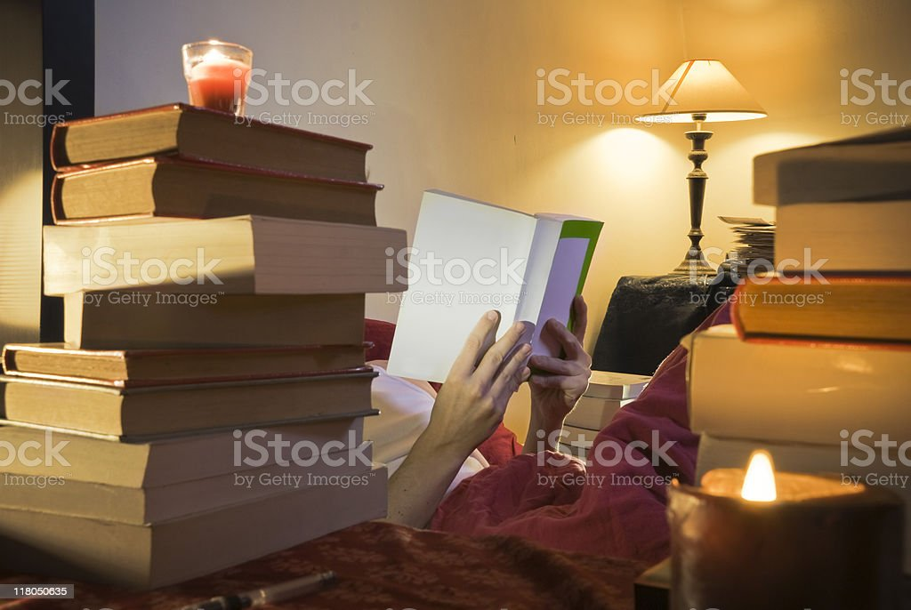 Reading in bed stock photo