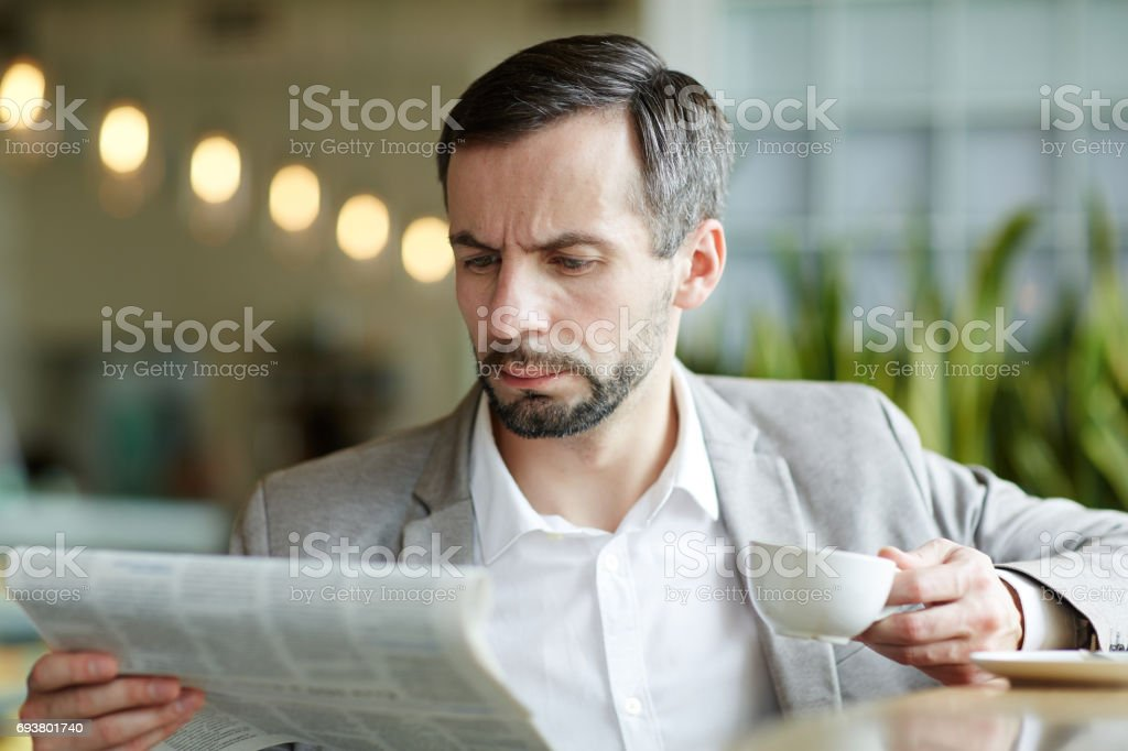 Reading in cafe stock photo