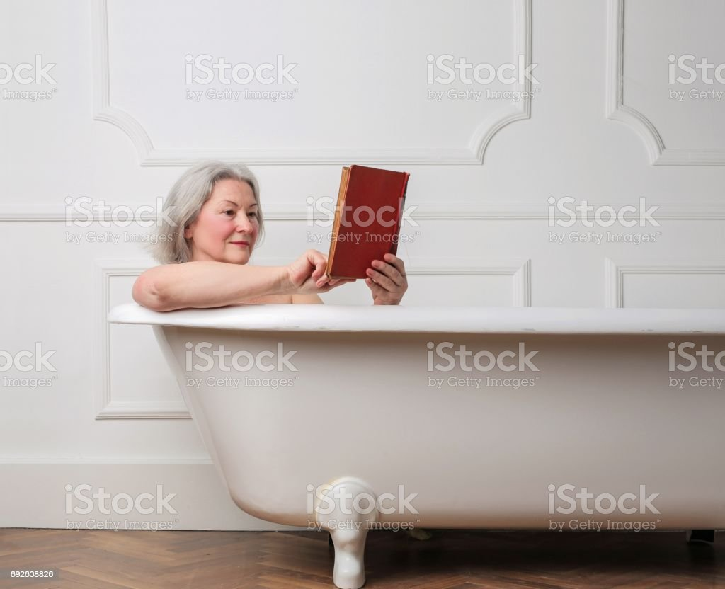 Reading In The Bath Tub Stock Photo & More Pictures of Adult | iStock