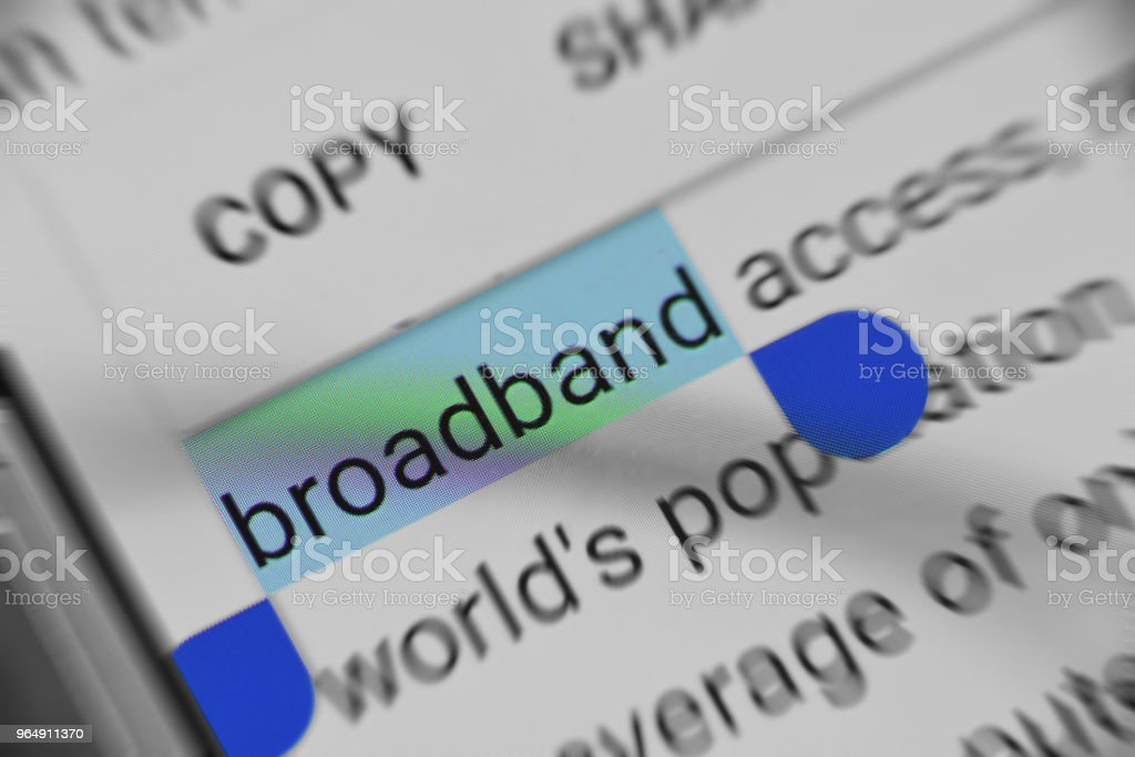 Reading information about 'Broadband' on digital device royalty-free stock photo