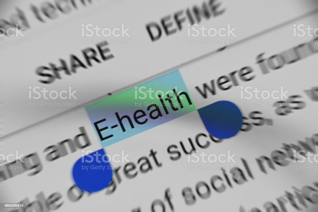 Reading information about 'E-Health' on digital device royalty-free stock photo