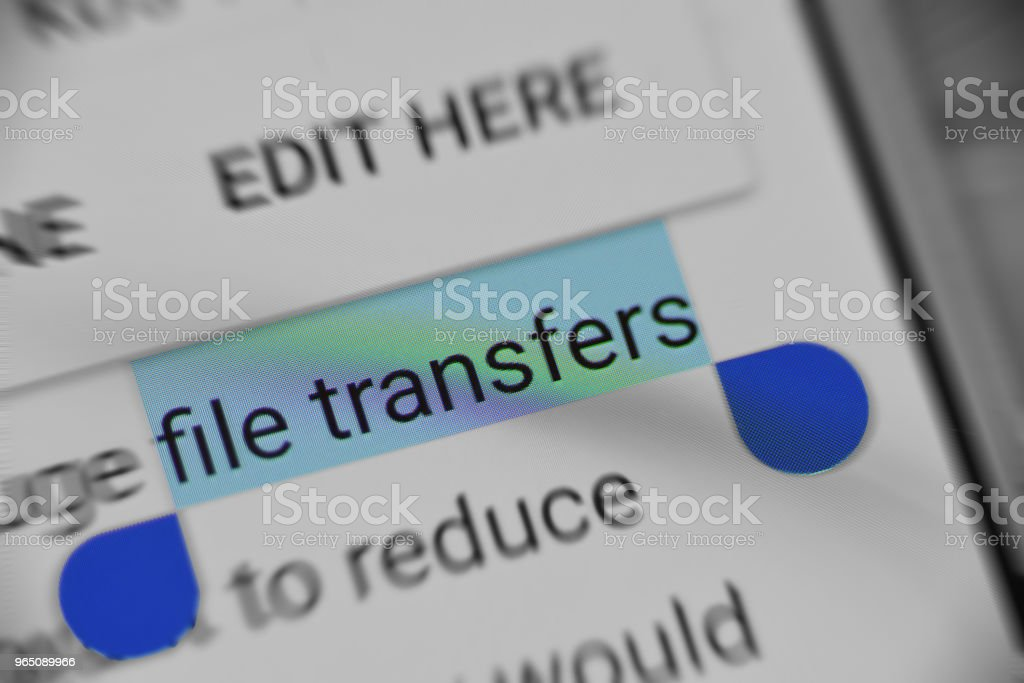 Reading information about 'File transfers' on digital device royalty-free stock photo