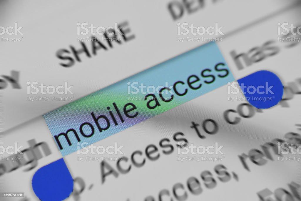 Reading information about Mobile access on Digital device zbiór zdjęć royalty-free