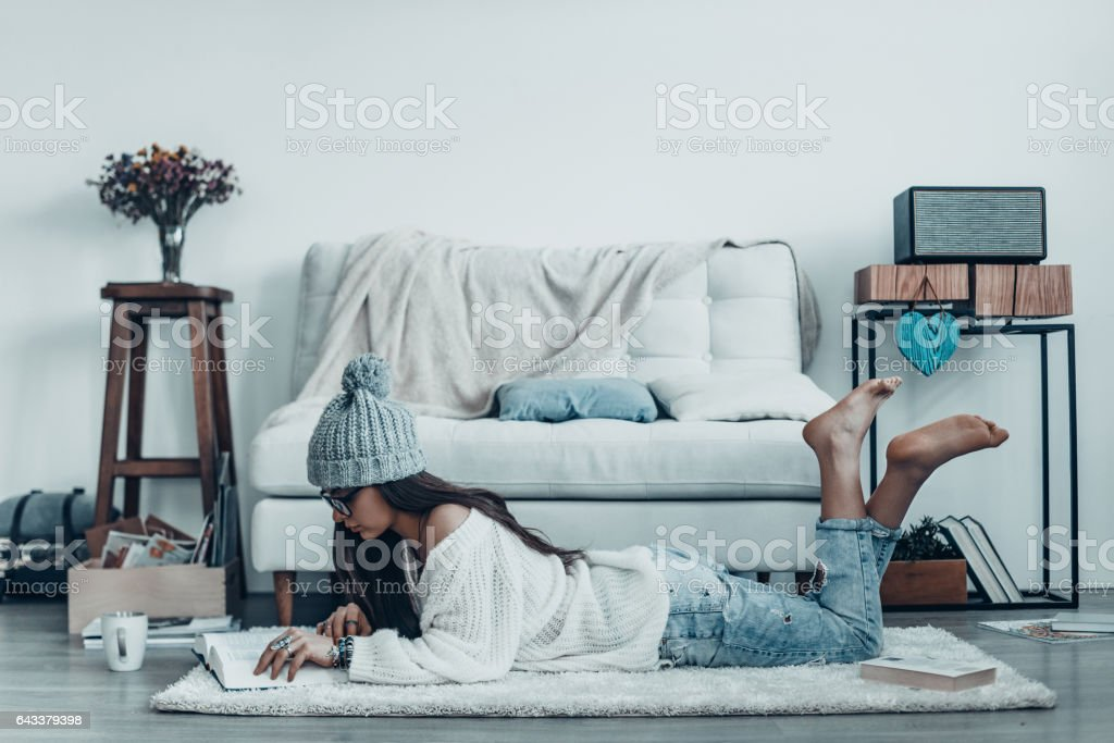 Reading interesting story. stock photo