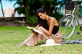 Beautiful woman relaxing with book