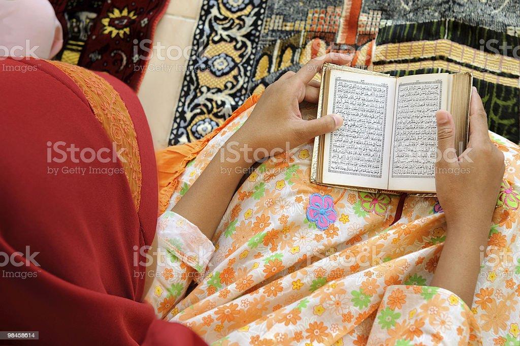 Reading Koran royalty-free stock photo