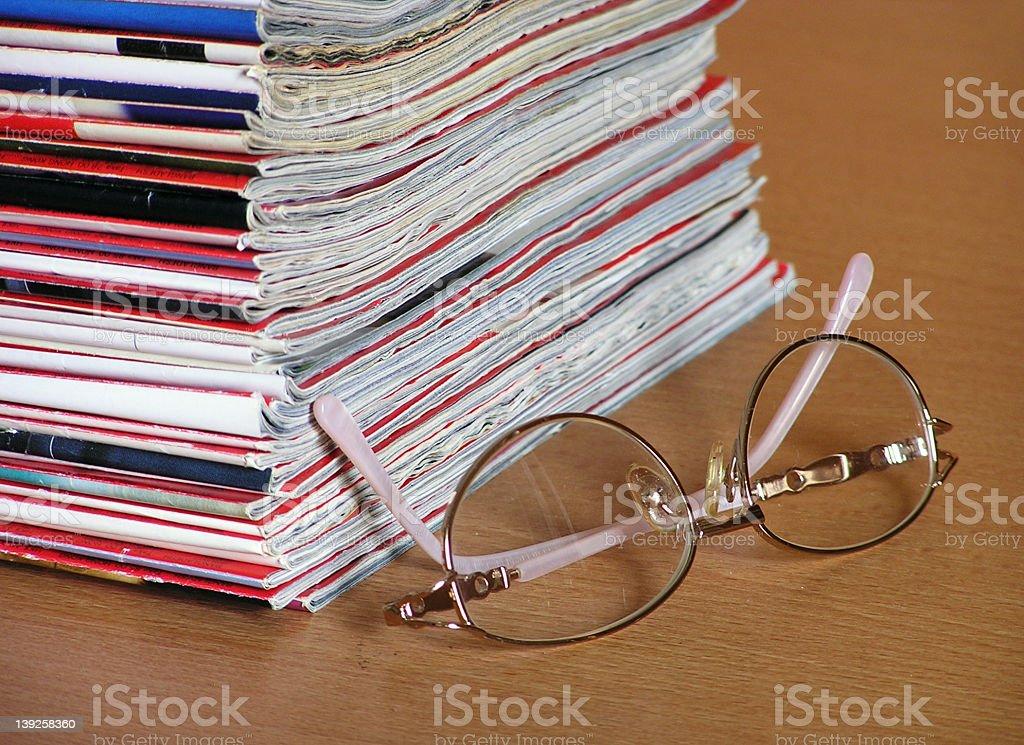 reading magazines royalty-free stock photo