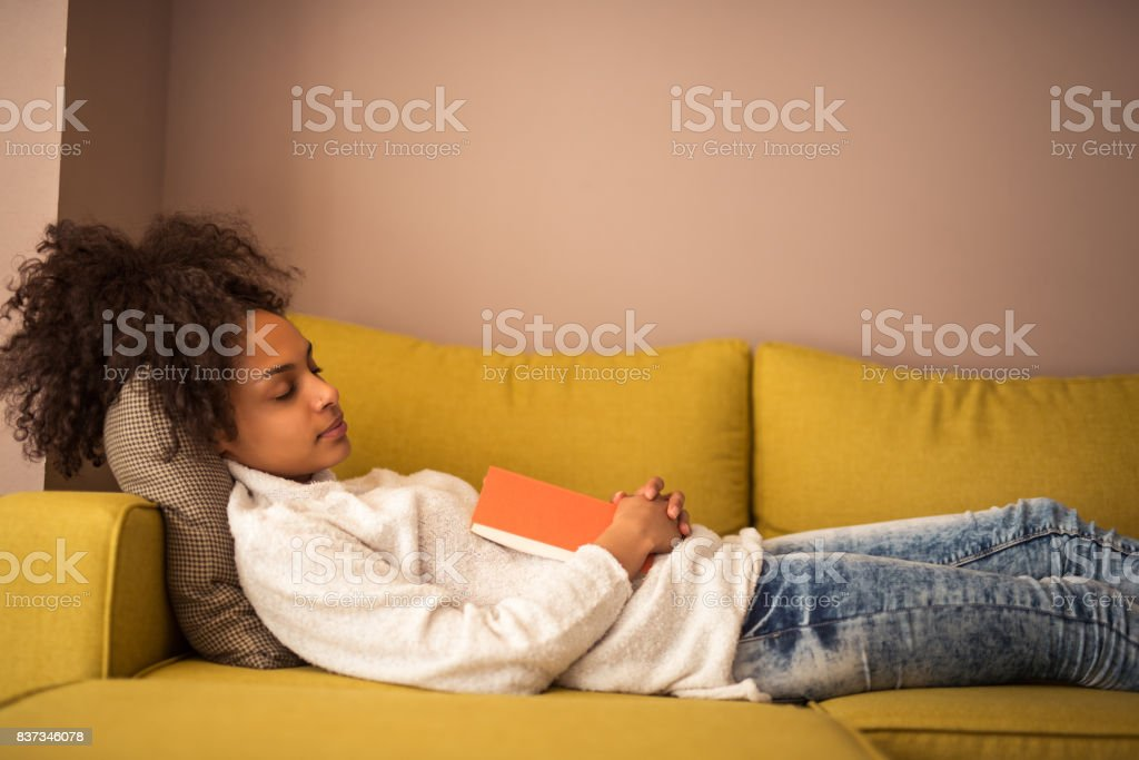 Reading makes her sleepy stock photo