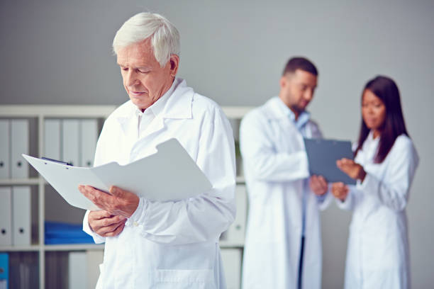 Reading medical records stock photo