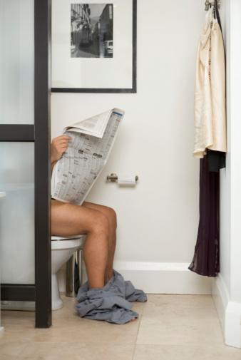 Reading Morning Newspaper on Toilet