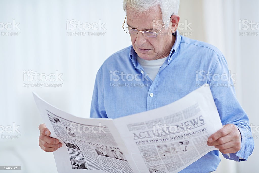 Reading morning paper royalty-free stock photo