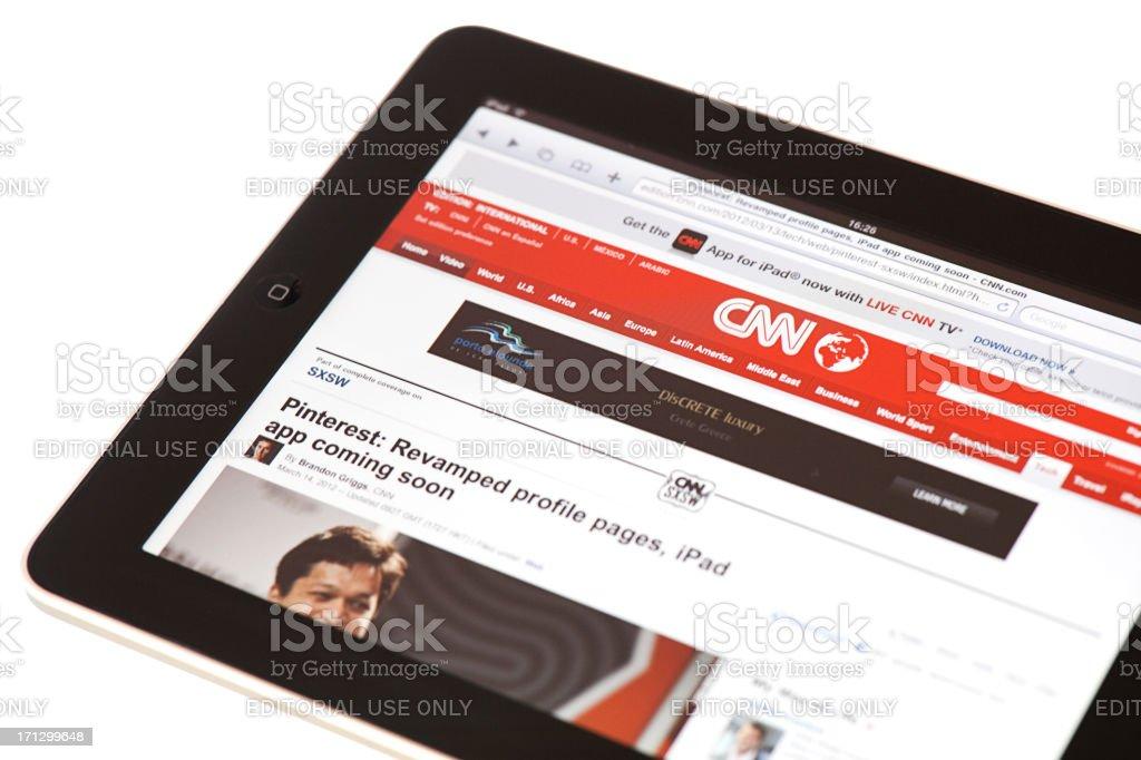 Reading news on  Apple iPad2 royalty-free stock photo