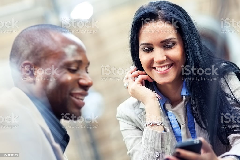 Reading News on Mobile Phone in Cafe royalty-free stock photo