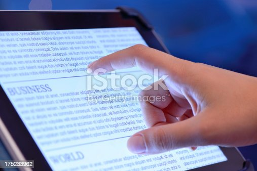 istock Reading news on tablet computer 175233962