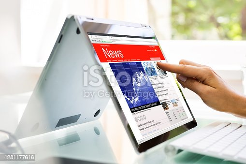 Reading News Website Or Electronic Newspaper On Screen