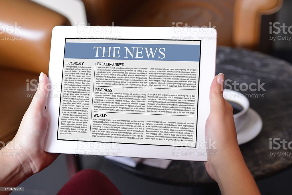 Reading news wit tablet pc royalty-free stock photo