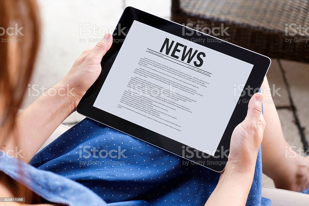 Reading news with tablet pc stock photo
