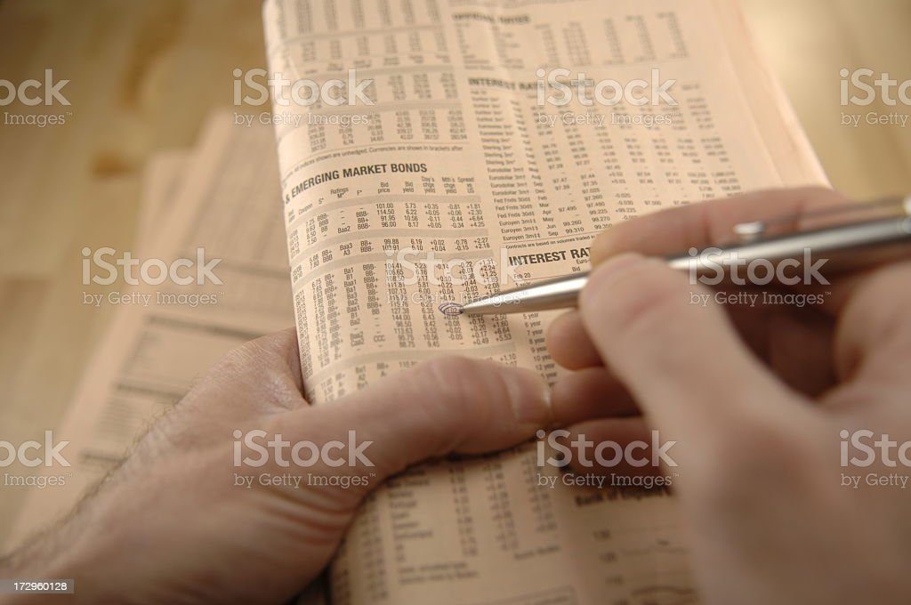 reading newspaper series stock photo