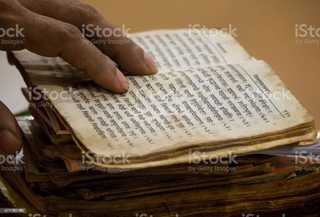 Reading old Hindu literature stock photo