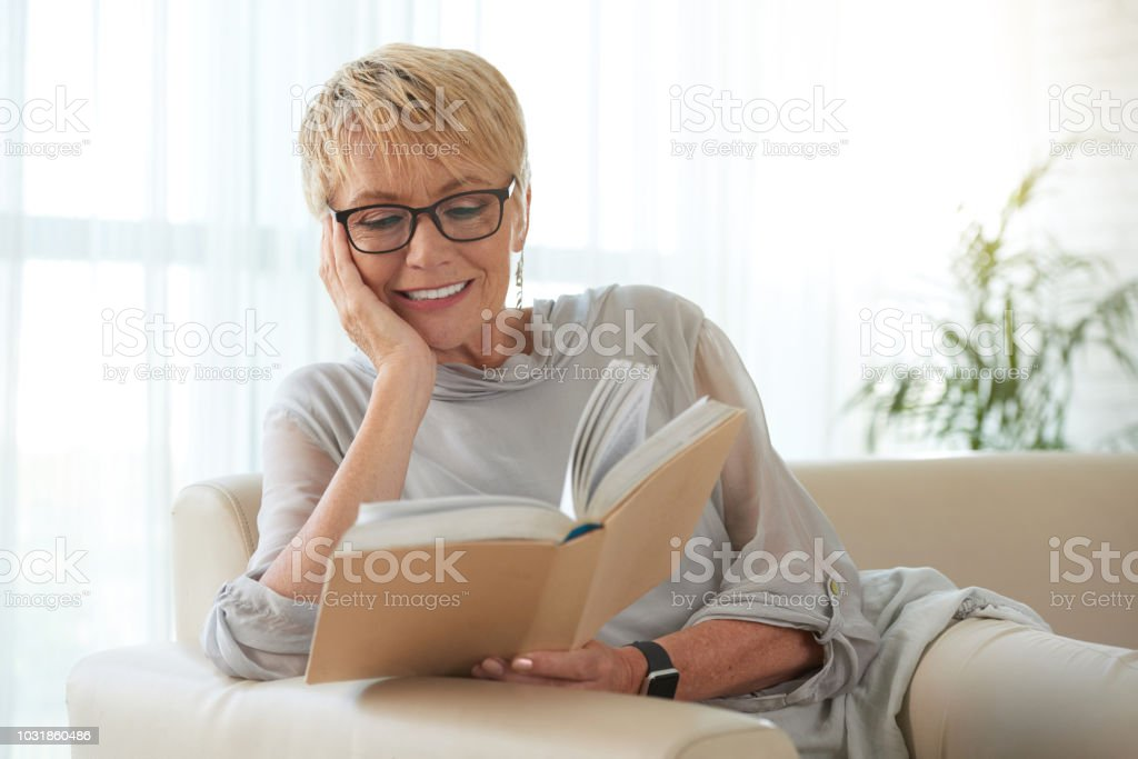 Reading old lady stock photo