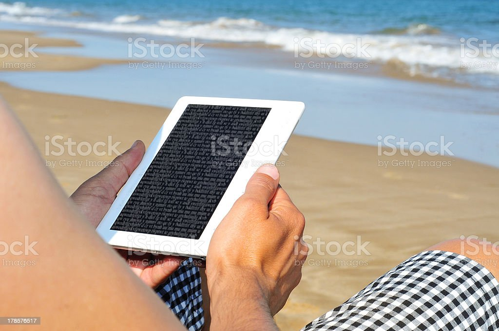 reading on an e-book royalty-free stock photo