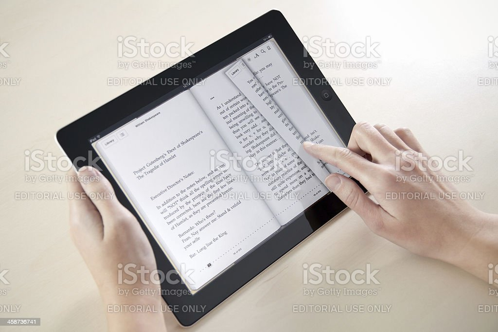 Reading On Apple iPad2 stock photo