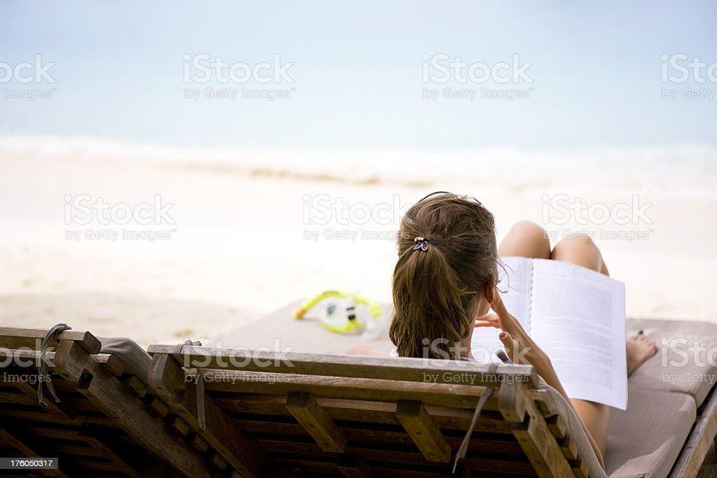 Reading on beach royalty-free stock photo