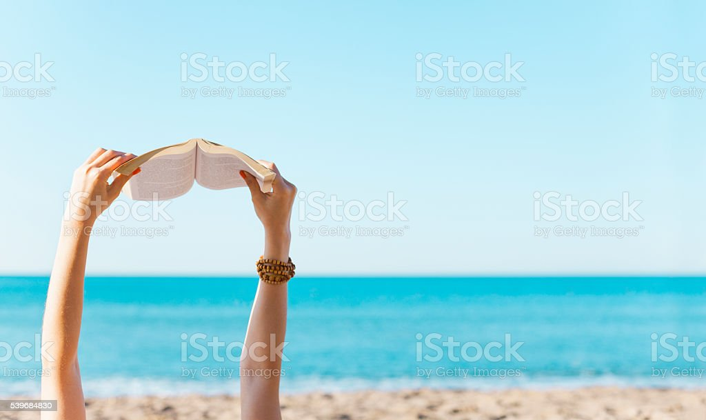 Reading on Beach stock photo