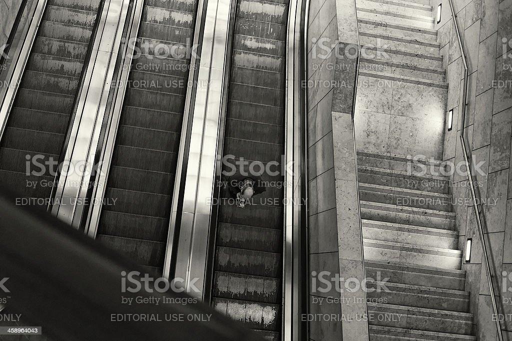 Reading on the Escalator royalty-free stock photo