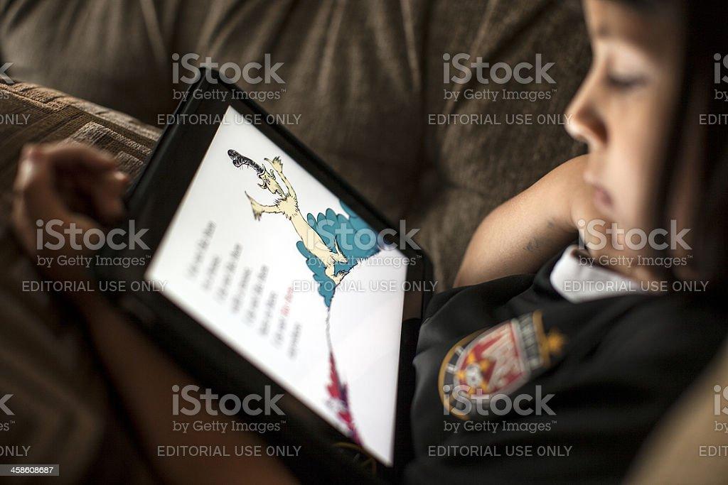 reading on the iPad royalty-free stock photo