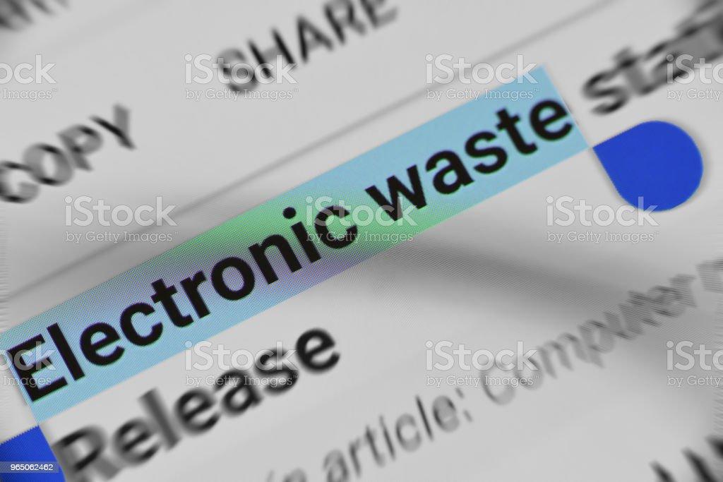 Reading Online information about Electronic Waste zbiór zdjęć royalty-free