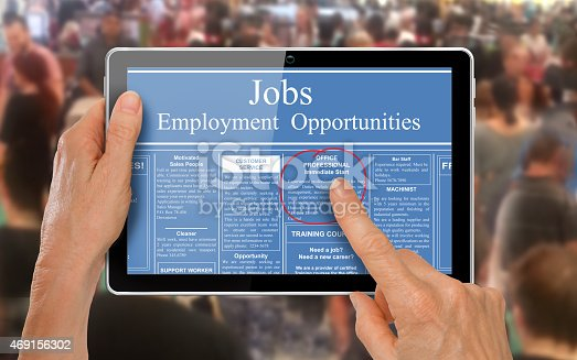 istock Reading online job ads on a computer tablet - 469156302
