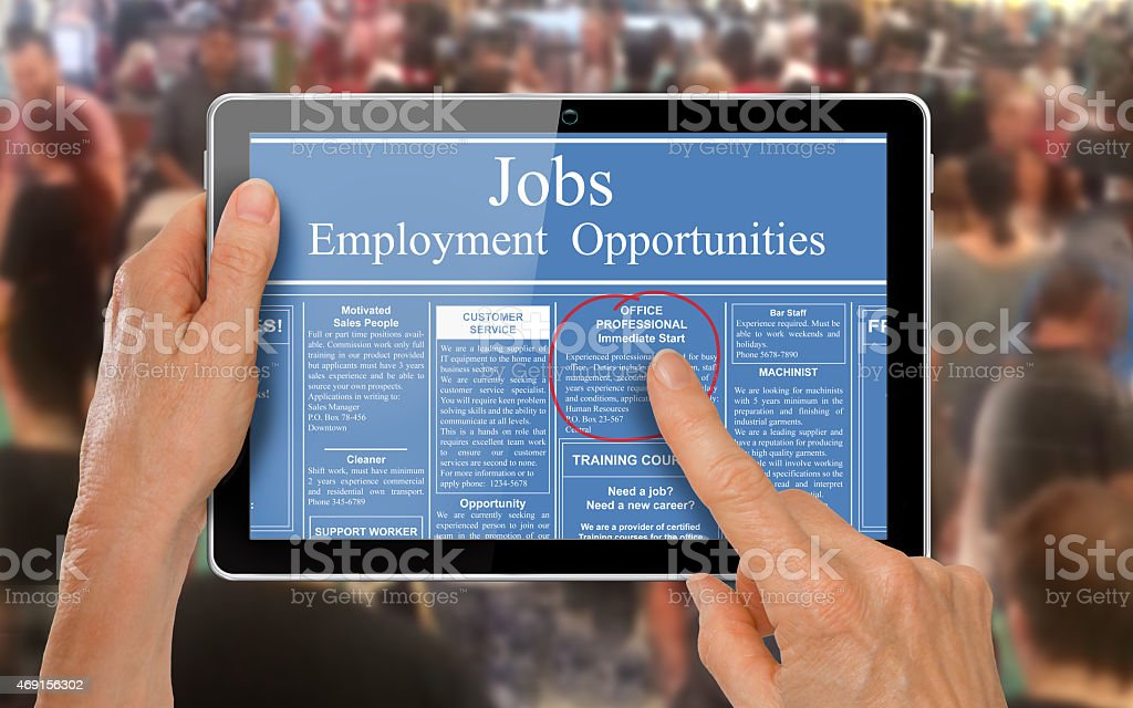 Reading online job ads on a computer tablet - stock photo