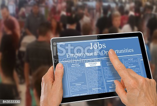 istock Reading online job ads on a computer tablet 843533330
