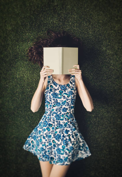 Reading outdoors stock photo