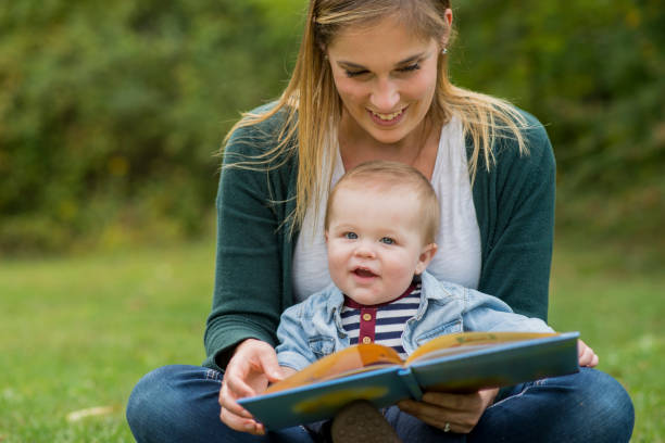 Reading Outside with Mom stock photo