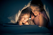 istock Reading past bedtime 187288989