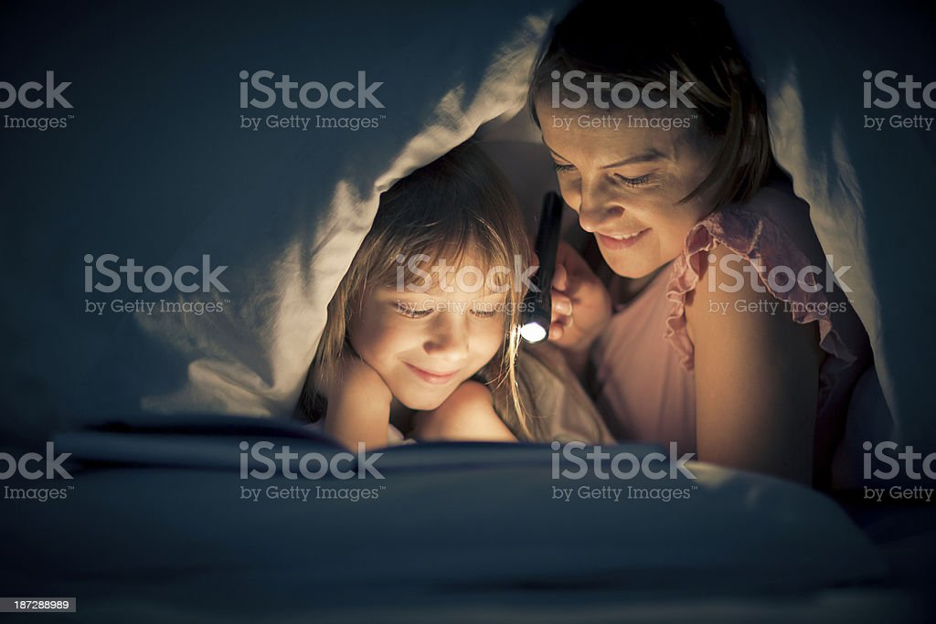 Reading past bedtime stock photo
